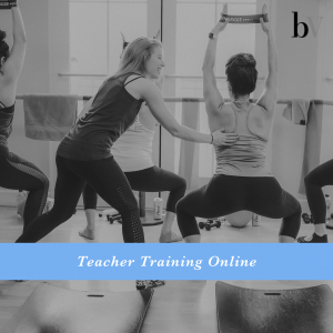 barre instructor helping student